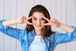 Happy woman peace blue jean
