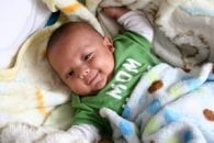 Baby smiling full stomach