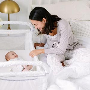 mother cosleeping safely with baby