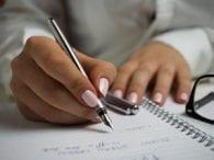Pink fingernails silver pen list notebook