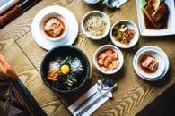 Probiotics, kimchi, wooden table