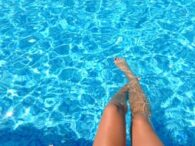 Relaxing pool legs reflections