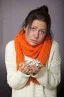 Weary woman flu pills