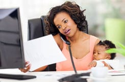 woman working with young baby