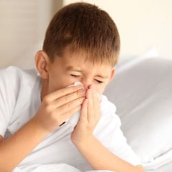 boy in bed with whooping cough thumbnail