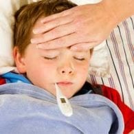 little boy in bed with flu