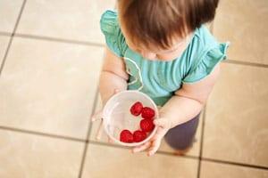 Toddler raspberries tile floor