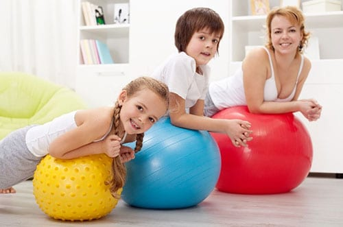 Mother with Children on Exercise Balls