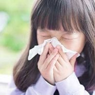 little girl blowing nose to prepare for cold season