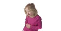 Child displaying signs abdominal pain