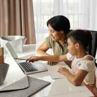 mom helping daughter with distance learning